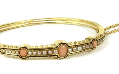 A Victorian gold coral and split pearl hinged bangle
