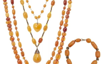 A collection of amber jewellery, early 20th...