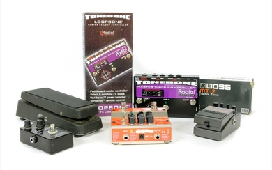 A group of five guitar effects pedals