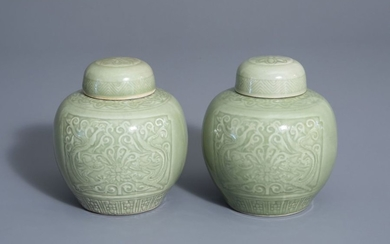 A pair of Chinese celadon jars and covers...