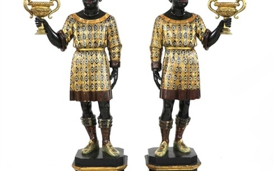 A pair of Venetian carved ebonised and polychrome painted blackamoors