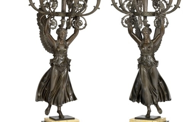 A pair of large French late Empire black patinated candelabra. First half of the 19th century. H. 95 cm. (2)