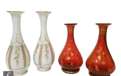 A pair of late 19th Century opaline glass vases of slender b...