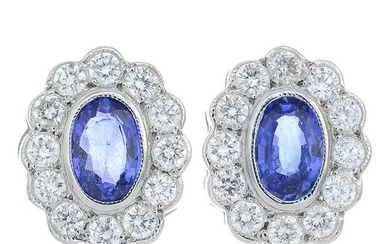 A pair of sapphire and diamond cluster earrings.Total