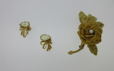 A rose brooch stamped '18k' together with a pair of