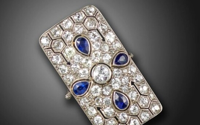 A sapphire and diamond rectangular plaque ring, pierced and decorated with pear-shaped sapphires and graduated old circular-cut diamonds in platinum, size O 1/2