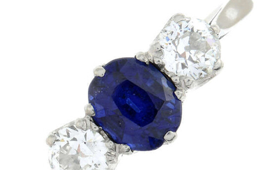 A sapphire and old-cut diamond three-stone ring.
