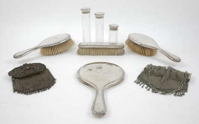 A seven-piece silver dressing table set, London,...