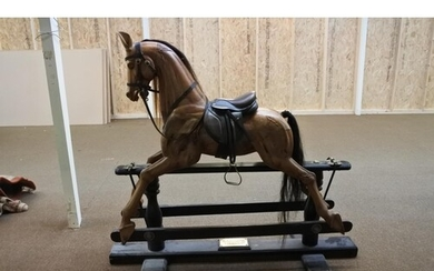A stunning hand carved limited edition glider rocking horse,...