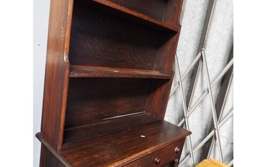 A vintage oak dresser the top having two plate rack above tw...