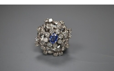 A white metal, sapphire and diamond set large cluster ring, ...