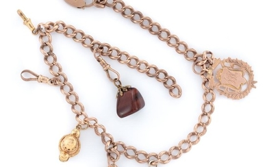 AN ANTIQUE 9CT GOLD ALBERT CHAIN WITH CHARMS; curb links to an hallmarked padlock clasp, Birmingham 1899, attached with a sporting p...
