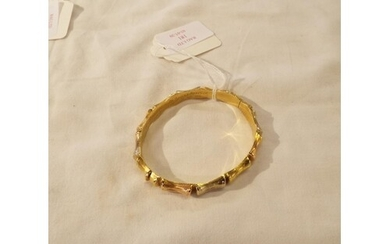 An 18ct gold bangle in the form of bamboo 17.2g