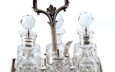 An English silver plated and glass cruet stand...