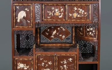 Beautiful oriental furniture in carved wood, with mother-of-pearl,...