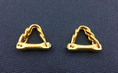 CARTIER. Pair of yellow gold cufflinks, stirrup shape...