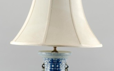 "CHINESE BLUE AND WHITE PORCELAIN VASE MOUNTED AS A TABLE LAMP Foo dog handles at sides of neck. Height to finial 30""."