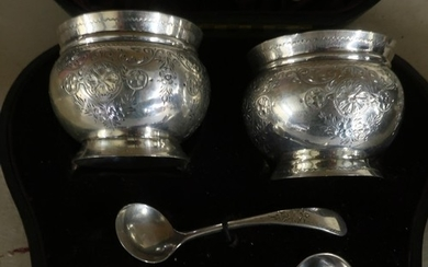 Cased pair of London silver hallmarked salts with blue glass...