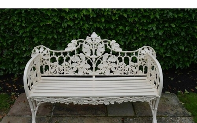 Cast iron garden seat decorated with oak leaves. { 100cm H X...