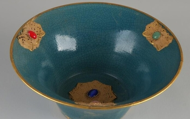 Chinese porcelain bowl with blue glaze and gold relief