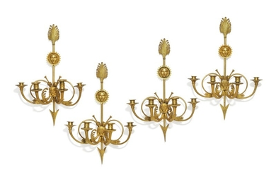 Claude Galle, attributed: A set of four French gilt bronze wall lights. Early 19th century. H. 64 cm. (4)