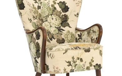 Alfred Christensen : Easy chair of stained beech. Upholstered with floral fabric. 1940s.