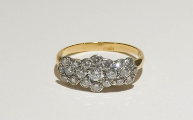 Diamond cluster ring, pave set with a triple flower head clu...