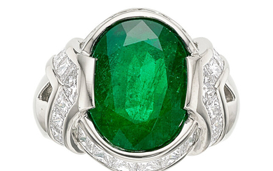 Emerald, Diamond, Platinum Ring The ring features an oval-shaped...