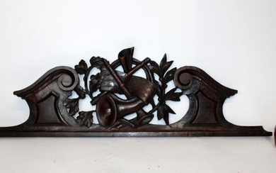 French carved walnut over door crest from music room