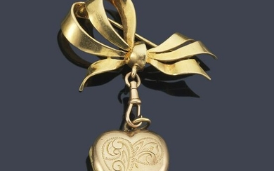 Gold bow-shaped brooch with picture frame pendant.