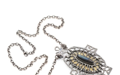 Helga Exner: A labradorite necklace set with cabochon-cut labradorite and gold leaf, mounted in oxidated sterling silver. Pendant L. 8.8 cm. Necklace L. 54 cm.