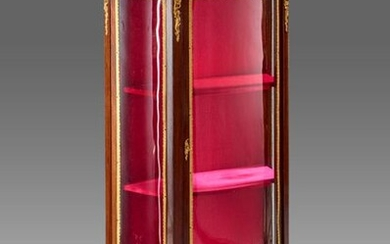 Mahogany showcase with curved front and sides. Red Morello cherry marble top with an openwork gallery.