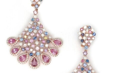 """Pair of earrings forming """" Aigrette """" in openwork pink gold, set with pink and blue sapphires punctuated with brilliant-cut diamonds. Total weight of the saphirs : approximately 16 carats. Clasp with stem and safety clasp. Longueur : 6.2 cm. P. Brut :..."""