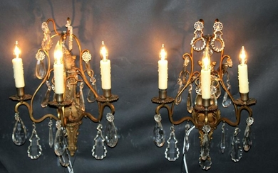 Pair of gilt bronze and crystal sconces
