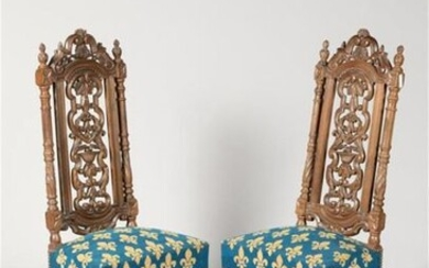 Pair of high back walnut Chairs with moulded, carved and openwork backrest, H-shaped spacer base. Small fleur-de-lys stitch upholstery. Louis XIII style, 19th century period. H. 126 cm.