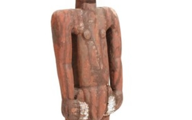 A 20th century African standing wooden figure with red pigment. H. 180 cm.