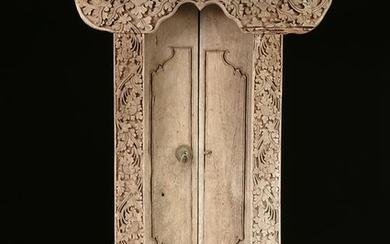 A BALINESE PADMA CARVED TEAK DOORWAY PORTAL, EARLY/MID