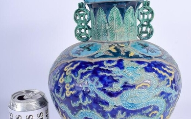 A CHINESE TWIN HANDLED PORCELAIN VASE 20th Century. 30