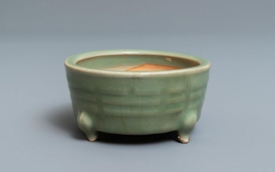 A Chinese Longquan celadon tripod censer with trigrams,...