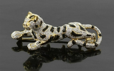 A Diamond Panther Brooch.