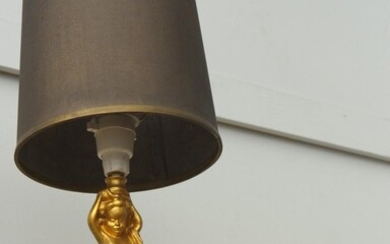 A GILT METAL CHERUB LAMP AND A SIMILAR PAIR OF CANDLE HOLDERS (ONE LUSTRE MISSING)