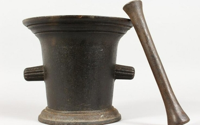 A LARGE CAST IRON PESTLE AND MORTAR. 8.5ins high.