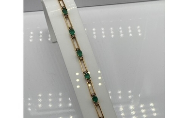 A Ladies 18k gold Diamond and Emerald bracelet. 0.64ct in to...