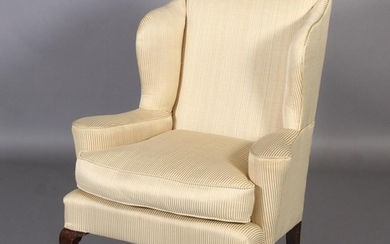 A QUEEN ANNE STYLE MAHOGANY WINGED ARMCHAIR, having an arche...