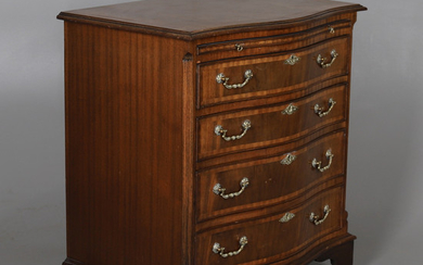 A REPRODUCTION CROSSBANDED MAHOGANY SERPENTINE CHEST.