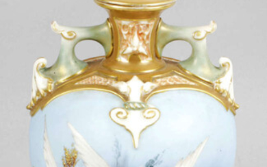 A Royal Worcester bone china vase and cover, decorated with a flight of five swans in the manner of Charlie Baldwin.