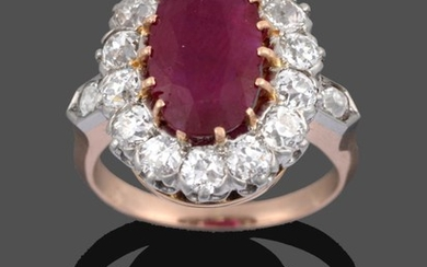 A Ruby and Diamond Cluster Ring, the oval cut ruby...