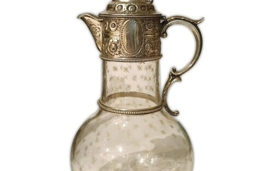 A Victorian hallmarked silver and clear glass claret jug the...