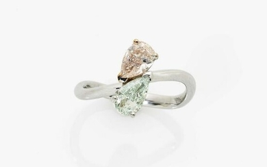 A Vis a Vis ring with natural light green and