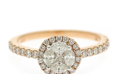 A diamond ring set with a princess-cut, four marquise-cut and numerous brilliant-cut diamonds, totalling app. 0.79 ct., mounted in 18k rose gold. Size 54.